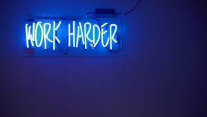 blue Work Harder neon signage
