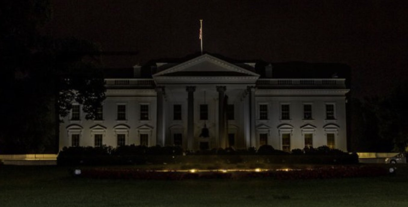 The White House at night, with the lights turned off.